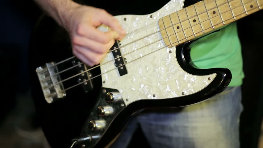 Electrical bass guitar in male hands