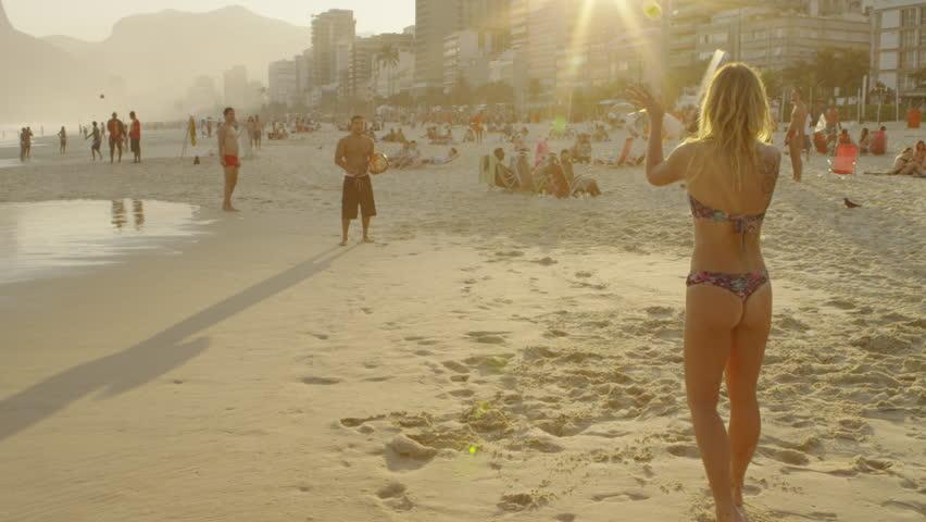 RIO DE JANEIRO, BRAZIL - JUNE 23: Slow motion shot of a couple playing tennis on