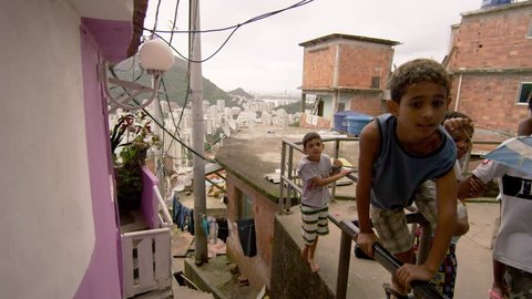 RIO DE JANEIRO, BRAZIL - JUNE 23: Slow dolly shot, favela occupants on Jun 23, 2013 in Rio, Brazil