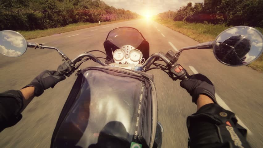 A motorcycle road adventure going forward to the sun in high speed. pov at sunset.  | Shutterstock HD Video #6144383