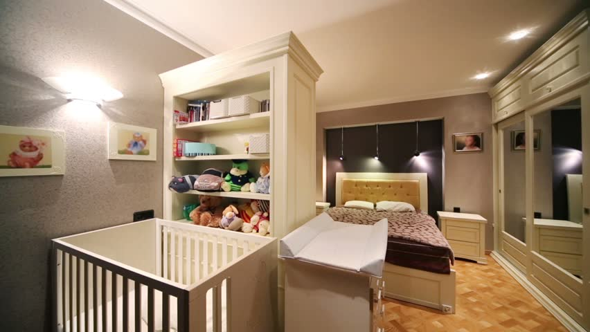 Studio Apartment With Baby white baby cot, closet with toys and bedroom in cozy and little