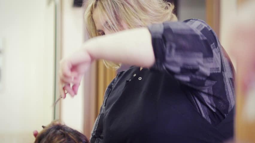 Hairdresser cuts woman's hair | Shutterstock HD Video #6167099