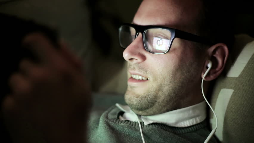 Man watching picture on tablet, closeup.