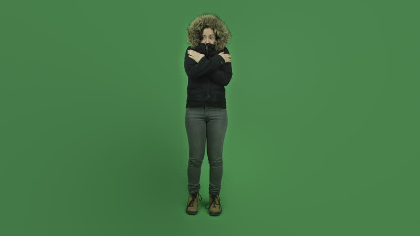 Caucasian girl young adult in her 30s with winter jacket isolated on chroma green screen background cold freezing | Shutterstock HD Video #6186503