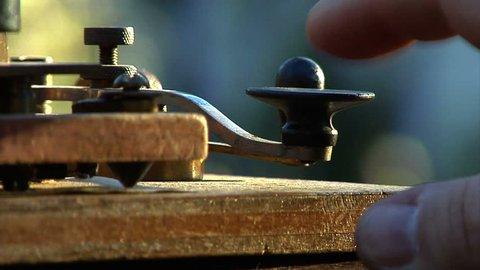 VIRGINIA - SUMMER 2013 - 19th Century Civil War/Old West, Western Telegraph Operator sending telegram with original telegraph machine. click, click, click. Railroad 1800s Western Union telegram.