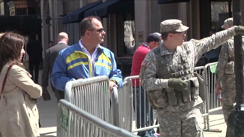 CIRCA 2010s - Soldiers and military guard the scene of the Boston Marathon bombing.