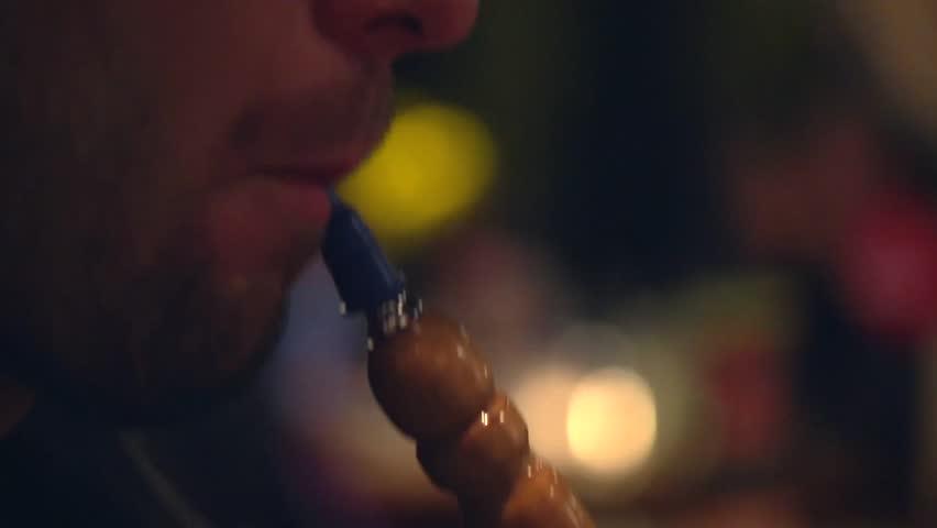 Man smoking shisha or hookah closeup. Full HD 1080 video footage