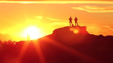Mountain Sunset Static HD video with silhouettes of people standing on the top of a peak.