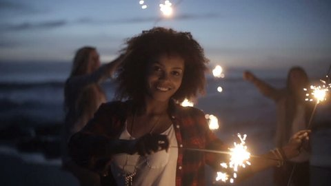 Group of friends with fireworks in slow motion
