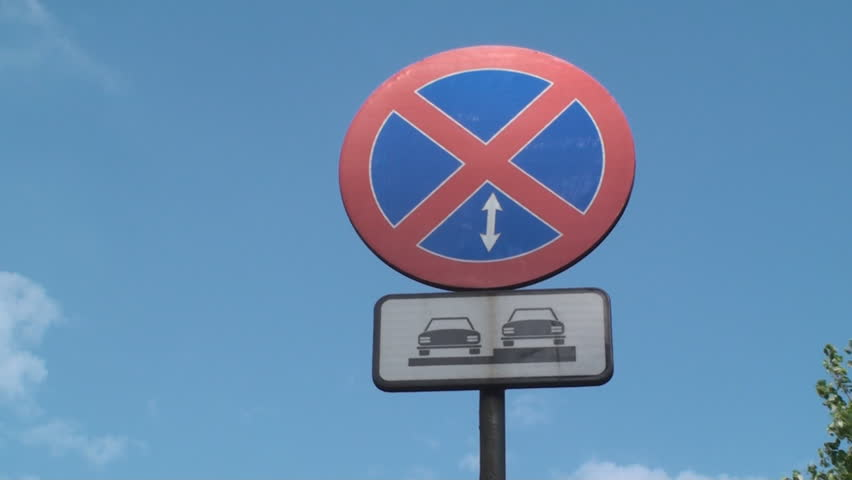 No Parking Allowed Here Street Sign, With A Blue Sky In Background, Low Angle | Shutterstock HD Video #6271943