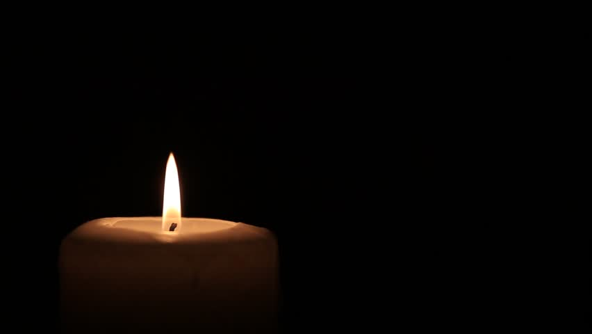 Close up of one candle burn against a black background   Shutterstock HD Video #6279443