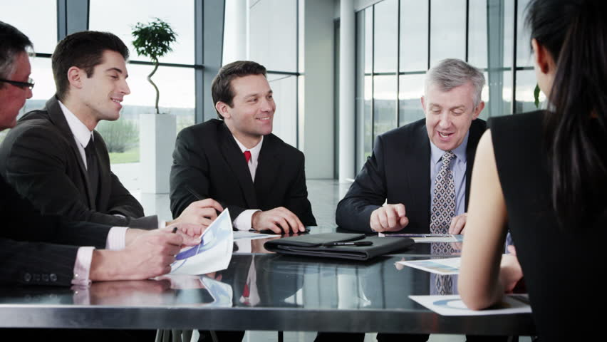 Cheerful diverse business group in discussion in a business meeting | Shutterstock HD Video #6284543