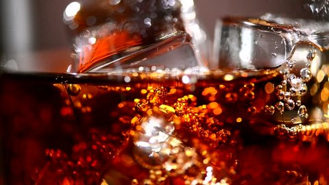 Cola background. Pouring Cola with Ice and bubbles in glass. Food background. Stock full HD video footage 1920x1080p, 1080