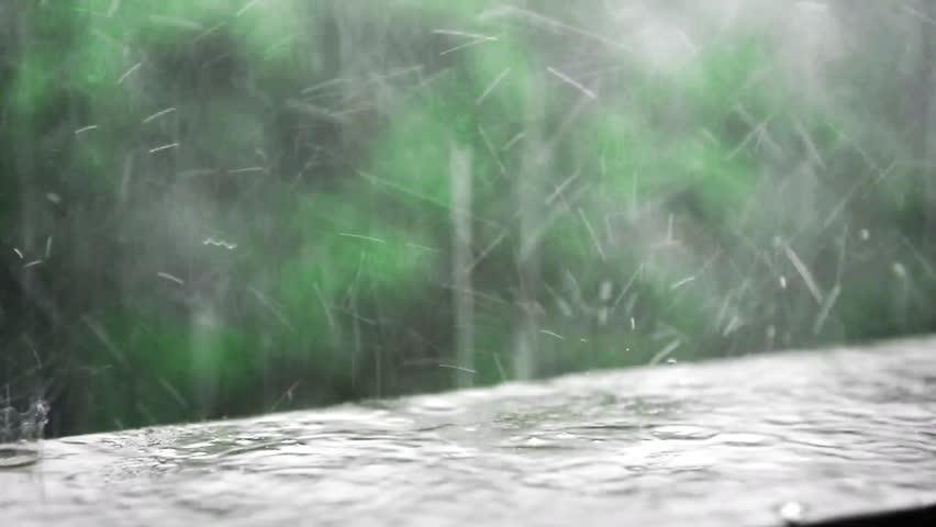 Single raindrop illuminated by sunshine disperses