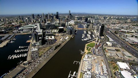An aerial shot of Melbourne City, along the Yarra River from Docklands to town