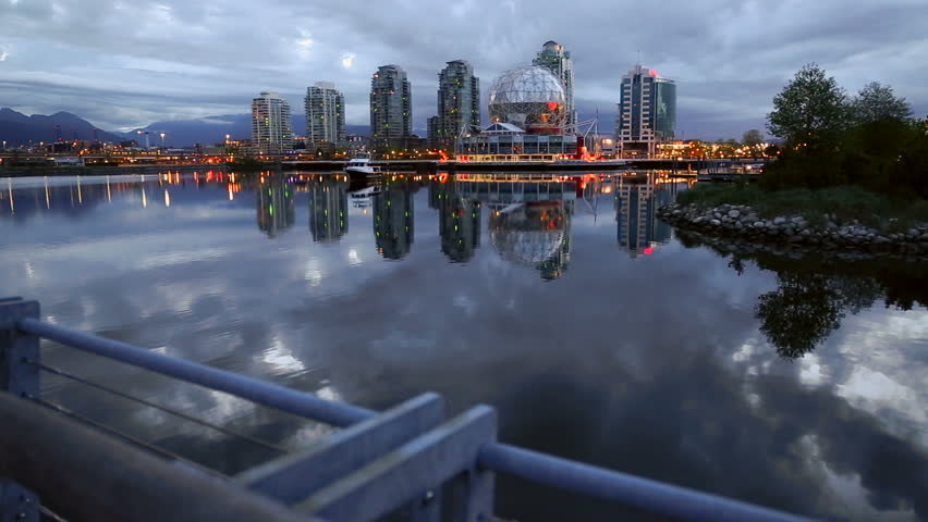 Dolly shot False Creek Dawn. A dolly shot of False Creek and the Vancouver skyline at dawn. British Columbia, Canada.