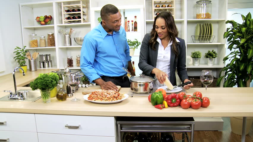 young ethnic business couple healthy food preparation