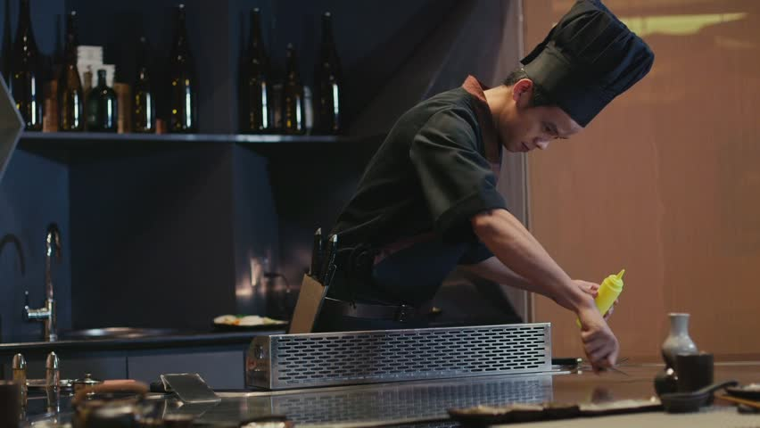 Restaurant Kitchen Video chef actively working in the kitchen of an asian restaurant, 4k