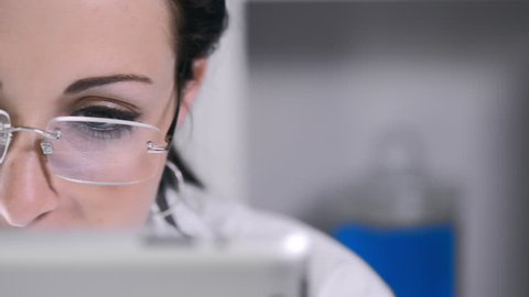 close up of lab technician using tablet computer