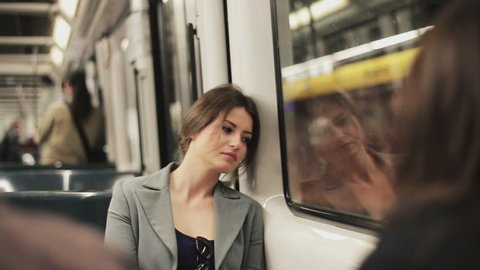 Sad woman sitting in the subway, steadycam shot