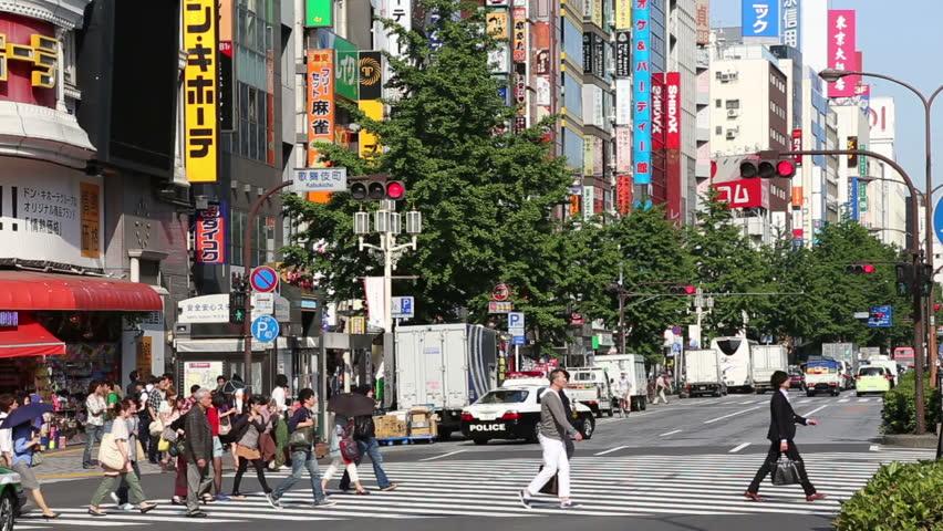 TOKYO, JAPAN - MAY 14: People cross the main street of Kabukicho in Tokyo, Japan on May 14, 2013. Kabukicho is an entertainment district in Shinjuku Ward, Tokyo. | Shutterstock HD Video #6410483