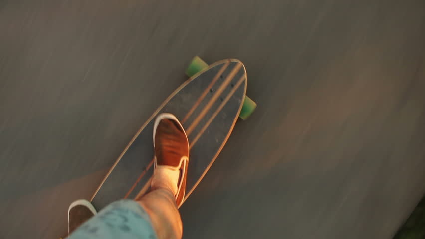 Shot on a longboard from the perspective of the longboard rider (pov). Driving on the asphalt. | Shutterstock Video #6417338