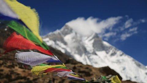 buddhist flag with nuptse peak nepal