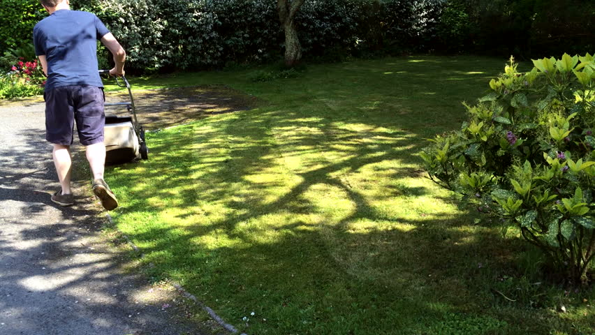 Cornwall, UK - 14th May: Gardens are growing fast and it's the time of year to put the lawn mower to work. Cornwall, UK - 14th May, 2014.