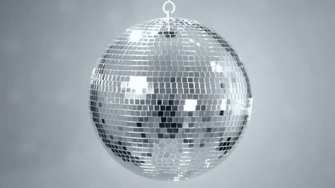 Mirror ball reflects white light. Disco ball with reflected moving rays. Loop.