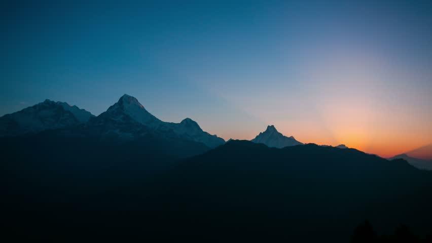 4k timelapse of sunrise at Himalaya mountains. Annapurna I, Annapurna South and Machapuchare mountain (Fishtail) within eyeshot. Poon hill, Ghorepani, Nepal.