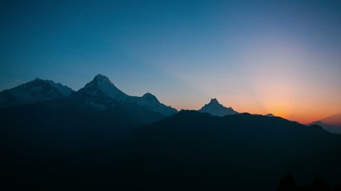 4k timelapse of sunrise at Himalaya mountains. Annapurna I, Annapurna South and Machapuchare mountain (Fishtail) within eyeshot. Poon hill, Ghorepani, Nepal.