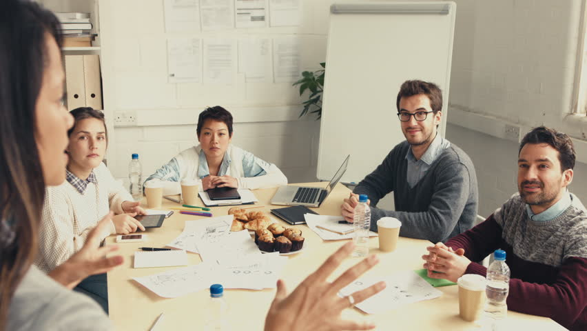 Group of young people in business meeting showing teamwork | Shutterstock HD Video #6528803