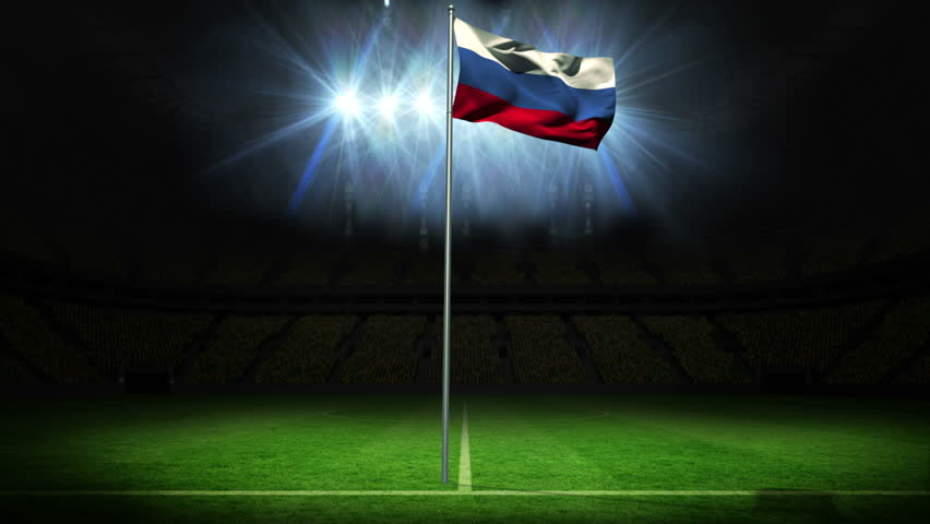 Russia national flag waving on flagpole against football pitch with spotlights and flashes | Shutterstock HD Video #6568874