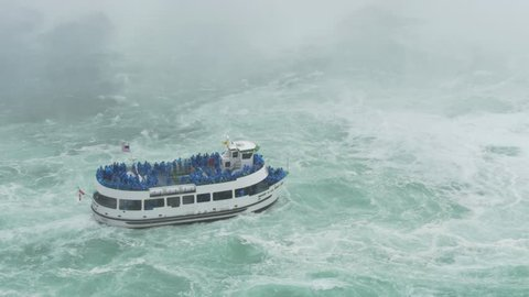 NIAGARA FALLS, CANADA - Circa, June, 2014 - Tourists aboard The Maid of the Mist approach Niagara Falls.  For editorial use only.
