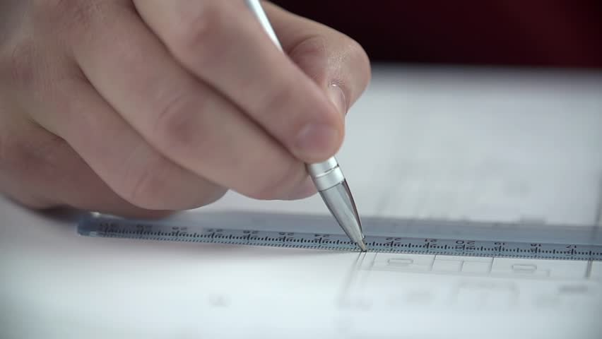 Hands draw lines with biro using the ruler   Shutterstock HD Video #6583583