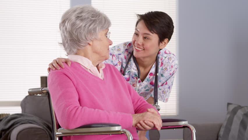 Asian nurse blows patient