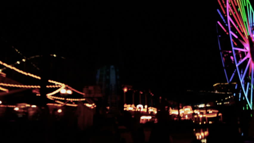 Roller-coaster at night, Bright theme park lights, fast ride