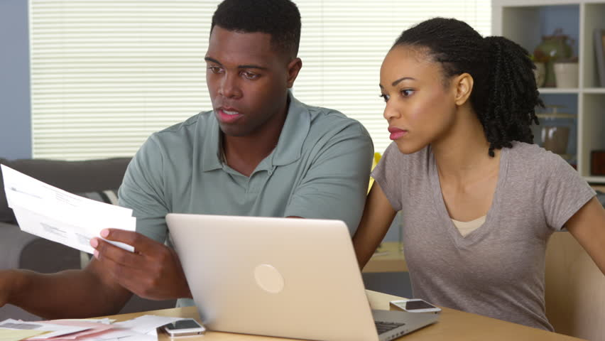 Serious young African American couple making bill payments online | Shutterstock HD Video #6645653