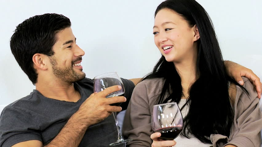 Close Up Casually Dressed Young Asian Chinese Couple Enjoying Time Together  Talking Drinking Glass Wine Home Sofa Slow Motion Stock Footage Video  6654473 | ...