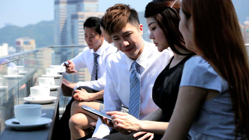 Team ambitious young male female ethnic business associates outdoors using wireless tablet smart phone technology modern city rooftop restaurant | Shutterstock HD Video #6676253