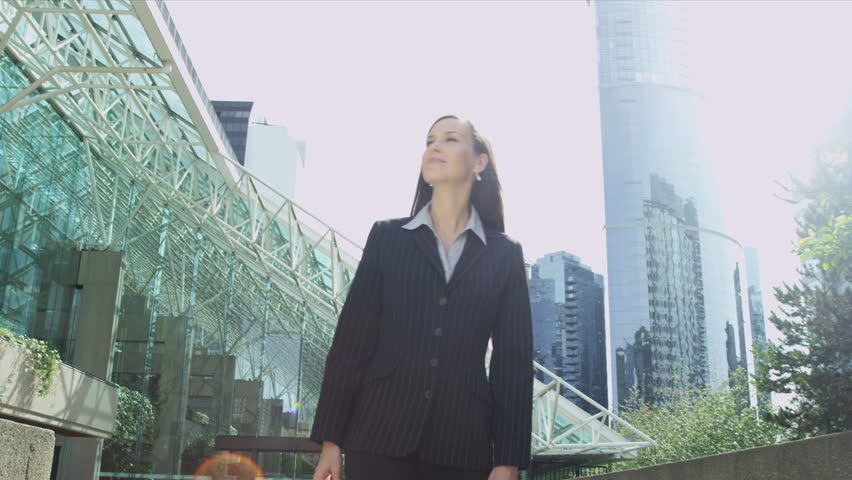 Female Broker Financial Investment Blank Touchscreen Technology - Female Caucasian share broker walking outdoors modern city operating blank touch screen using graphic overlays shot on RED EPIC | Shutterstock HD Video #6700583