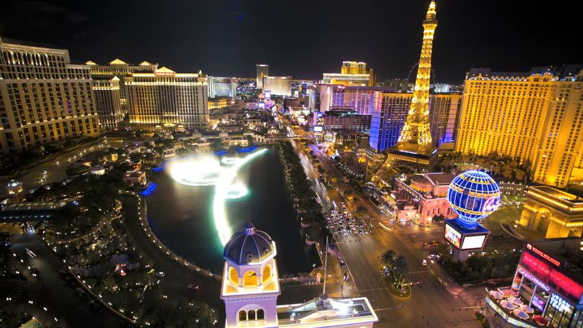 Las Vegas - January 2014: Time lapse illuminated Bellagio Hotel fountain Eiffel Tower Caesars Palace Las Vegas Blvd, Nevada, USA   Shutterstock HD Video #6714217