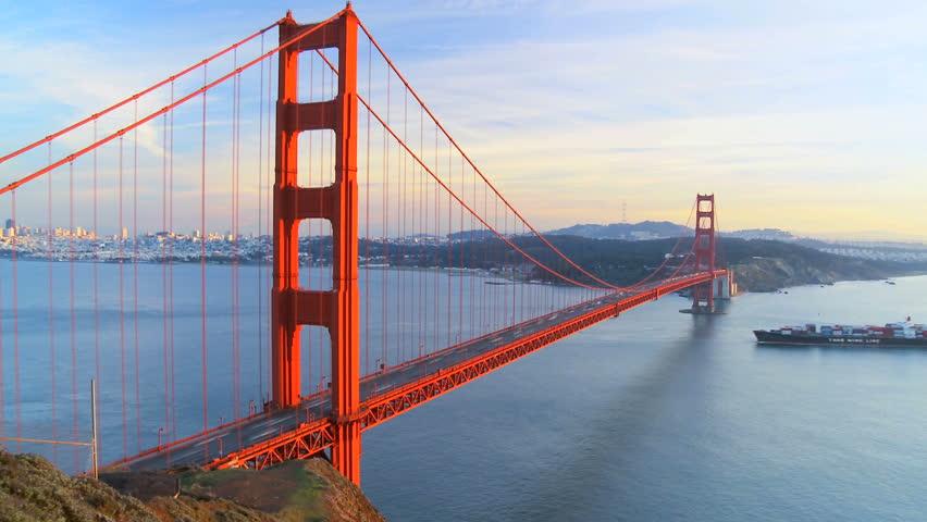 Time-lapse view of traffic on Golden Gate Bridge, San Francisco & shipping below