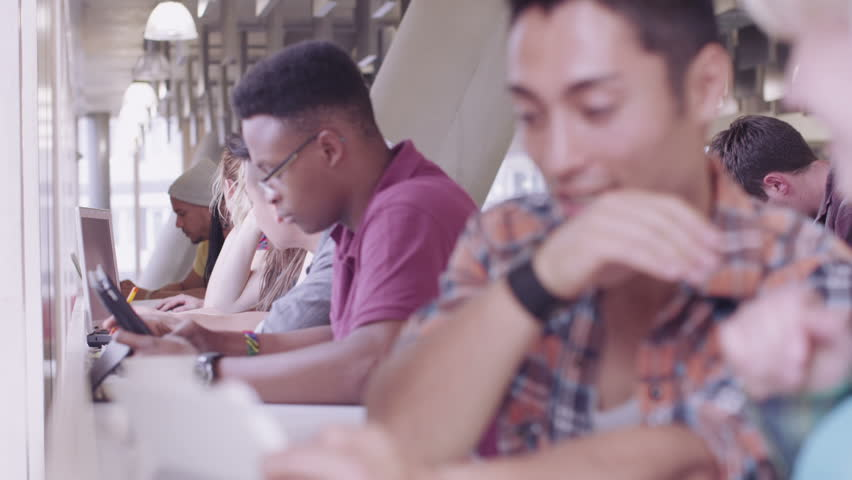Cheerful diverse student group chatting & working together in college cafe area | Shutterstock HD Video #6785992
