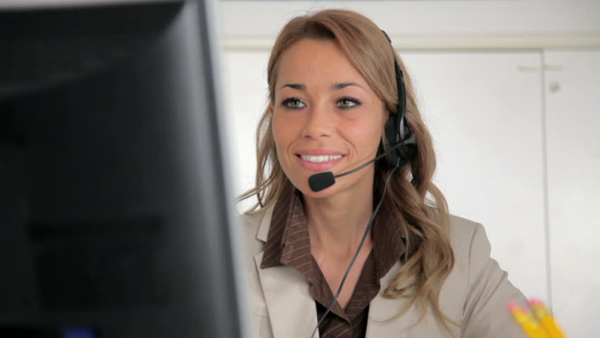 Female receptionist working on computer and talking on the telephone in call center. Sequence | Shutterstock HD Video #679012