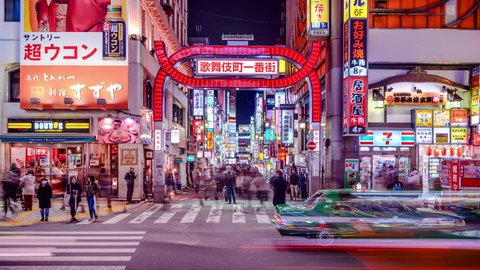 TOKYO, JAPAN - MARCH 14, 2014: Traffic in Kabuki-cho district of Shinjuku Ward. The area is a renown nightlife and red-light district.