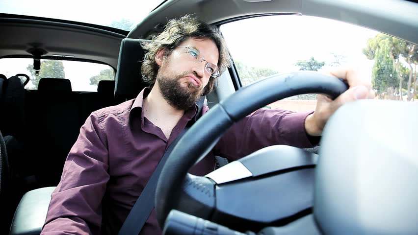 Man in car angry stock in traffic | Shutterstock HD Video #6803293