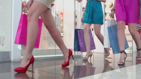 Cropped shot of female legs walking leisurely along the shop departments