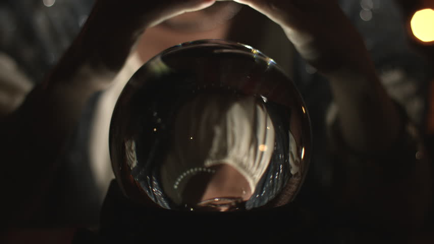Fortune teller unveils a crystal ball.  Close up on crystal.  UHD 4K.