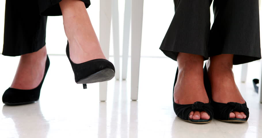 Businesswoman shaking her feet nervously in the office